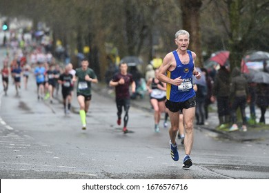 Bath, UK - March 15, 2020: Runners take part in the Bath Half Marathon. The race went ahead despite most mass public gatherings and sports events being cancelled due to the covid-19 pandemic.