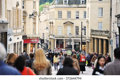 BATH, UK - MAY 1, 2014: Crowds of people walk along a busy city centre street. The landmark Somerset UNESCO World Heritage city is popular travel destination with over 4 million visitors per year.