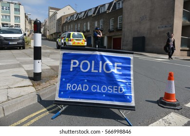 Bath, UK - May 13, 2016: A closed road sign sits at a roadblock in the vicinity of an unexploded WWII bomb found at a construction site. Police evacuated thousands of residents after the discovery.