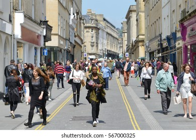 Bath, UK - May 13, 2016: Tourists and locals walk along a city centre street on a sunny day. The Somerset city of Bath has UNESCO World Heritage status and receives over 4 million visitors each year.