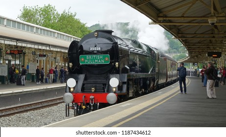 Bath, UK - May 16, 2018: The British Pullman steam train engine stops at Bath Spa railway station.