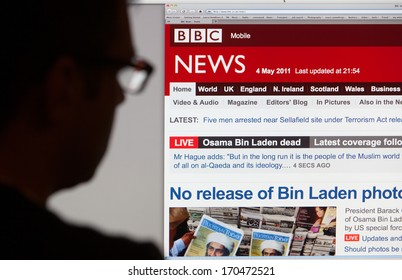 BATH, UK - MAY 4, 2011: A silhouetted man views the latest stories on the BBC News website on 4th May 2011. The headlines are dominated by the death of Osama Bin Laden which happened on 2nd May 2011.