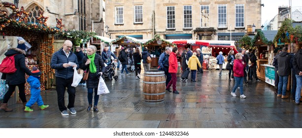 BATH, UK - NOVEMBER 29, 2018: People shopping at Bath Christmas Market.