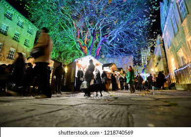 Bath, UK - November 30, 2014: Crowds of people visit the Christmas Market in the streets surrounding Bath Abbey. The market has become an annual fixture for the historic Unesco World Heritage City.
