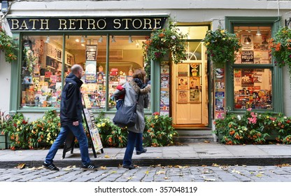 BATH, uk - OCT 18, 2015: People walk past a retro store on a city centre street. The Unesco World Heritage city in Somerset is famous for it shopping, attracting around 4 million visitors a year.