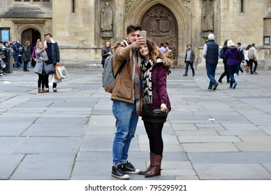 Bath, UK - Oct 18, 2015: A couple take a selfie in a square outside the landmark Bath Abbey. The Unesco World Heritage city in Somerset is a popular travel destination with 4 million visits a year.