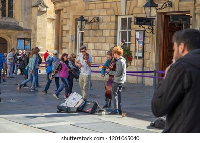 Bath, UK: October 09, 2018: Buskers outside The Roman Baths  Abbey Curchyard Entrance