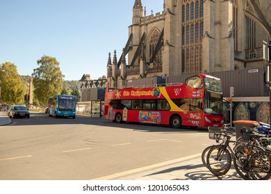 Bath, UK: October 09, 2018: Bath Tour Bus and Local Bus outside Bath Abbey
