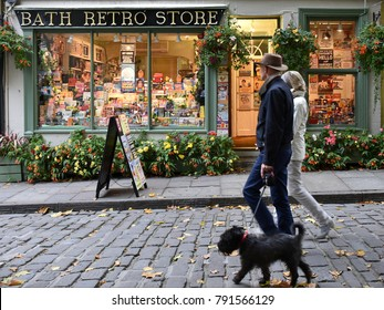 Bath, UK - October 18, 2015: People walk past a retro store on a city centre street. The Somerset city of Bath is famous for its shopping and sightseeing, attracting 4 million visitors a year.