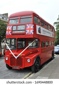 Bath, UK - October 5, 2012: A vintage London Red bus is seen on a city centre street.