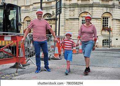 Bath, UK - September 28, 2012: A family dress up as the fictional character Wally from the British puzzle book series Where's Wally by author and illustrator Martin Handford.