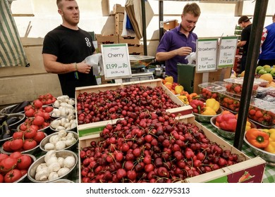 BATH, UNITED KINGDOM - JUNE 6, 2014: Exciting, fresh and colourful summer produce  easily found and been sold almost daily at farmers' market by the traders and street vendors during the season