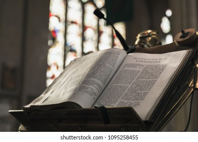 Bath, United Kingdom - November 2, 2017: Open Bible lays in Abbey Church of St.Peter and St.Paul, commonly known as Bath Abbey