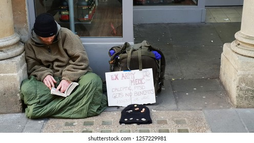 Bath,  Wiltshire, UK; Dec 2018: Homless Ex-Military with sign describing his condition; Suffering from PTSD and depression living on the streets, with no benefits.