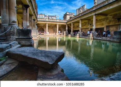 BATH/ENGLAND - JUNE 20, 2017: An HDR image (created from multiple photos blended together) of the Great Bath in the Roman Baths attraction in the historic town of Bath.