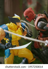 BATHIN SOLAPAN, INDONESIA - ARPIL 10, 2021: This is Toy Photography. The wolverine fight against the deadpool in the forest.