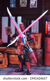 BATHIN SOLAPAN, INDONESIA - FEBRUARY 17, 2021: This is Toy Photography. The Deadpool has two swords from the Gundam sequel.