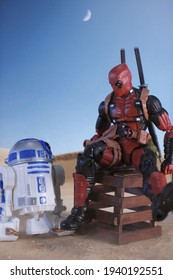 BATHIN SOLAPAN, INDONESIA - JANUARY 30, 2021: This is Toy Photography. The Deadpool meets BB-8 in the dessert.