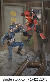 BATHIN SOLAPAN, INDONESIA - MARCH 7, 2021: This is Toy Photography. Steve Roger, Captain America fight against Deadpool