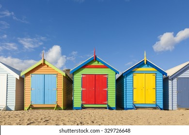 Bathing boxes in a beach against blue sky with copyspace