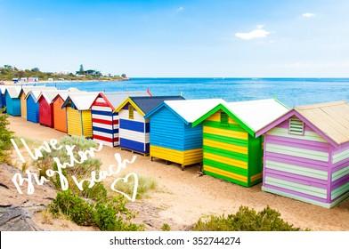 Bathing boxes at Brighton Beach, Australia with hand written text Brighton, Australia