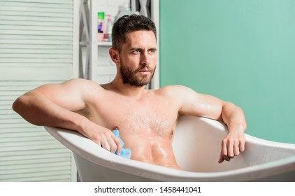 Bathing can improve heart health. Personal hygiene. Take care hygiene. Cleaning parts body. Hygiene concept. Man muscular torso sit in bathtub. Skin care. Hygienic procedure concept. Total relaxation.