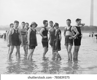 Bathing fashions in the 1910s. Men were required to wear tank tops for coverage of their nipples at the beach. Washington, D.C., 1912-1920
