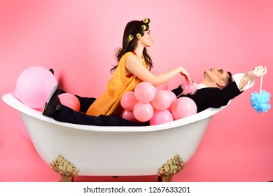 Bathing hygiene habits. Couple in love in bath tub. Couple of mime man and sexy woman enjoy bathing. Bubble bath day. Beauty routine and personal hygiene. Hair grooming routine. Washing regularly.