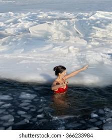 Bathing in the sea in winter hole,