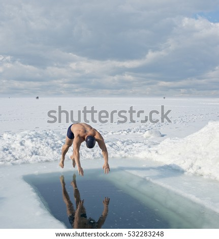 Bathing in the sea in winter hole, Vladivostok, Primorye