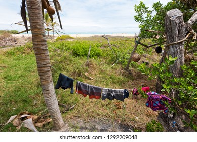 Bathing suits drying on a line in the Galapagos looking out to sea