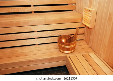 bathing wash-tub and a scoop in the sauna