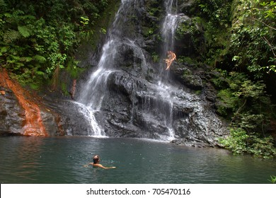 Bathing in a waterfall in Cockscomb national park, Belize