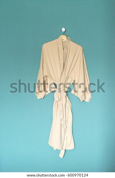 Bathrobe hanging on a blue wall at Spa/massage center