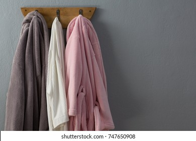 Bathrobes hanging on hook against wall