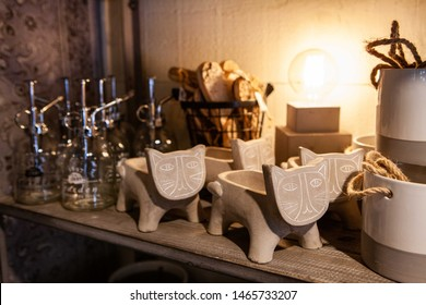 Bathroom accessories in homeware shop. A close-up view of decorative ornamental bathroom objects on a shelf inside an environmentally friendly home wares store.