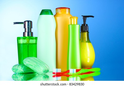 bathroom accessories and soap on blue background