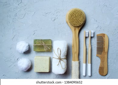 Bathroom amenities on a gray background. Massage towel and brush. Spa Kit. Zero waste product