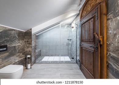 Bathroom in attic apartment, shower cabin