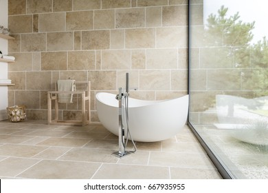 Bathroom with big window and wooden accesorises