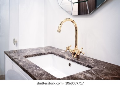 Bathroom classic nterior with sink and classic retro style faucet
