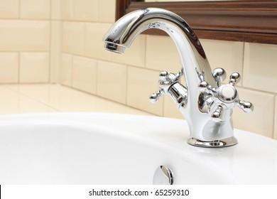 Bathroom closeup - sink, faucet and tile