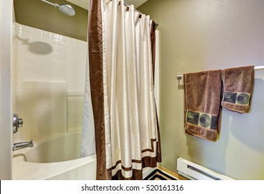 Tub And Shower Combo With White Brown Curtain Green Walls