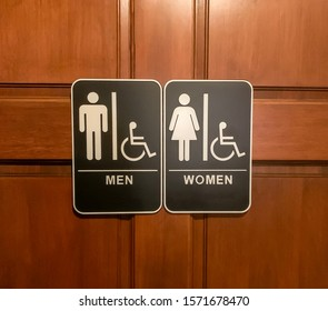 A bathroom door designates a gender neutral policy with both male and female signs.