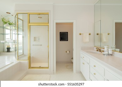 Bathroom with Gold appliances