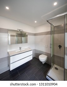 Bathroom with gray tiles and nobody inside. Elegant and luxurious