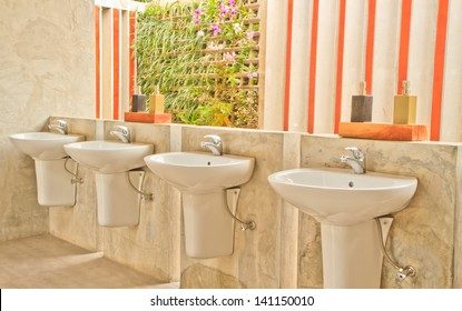 Bathroom with hand washing liquid on color wall background