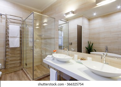 bathroom of the hotel rooms, with a shower and a few washbasins.