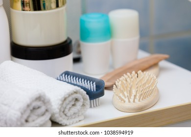 Bathroom hygiene objects concept. Sponges, brushes, towels and creams. Indoor interior shot.