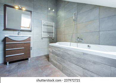 Bathroom interior with bath and wooden shelf
